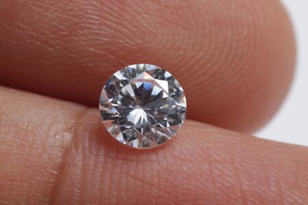 Macro shoots of a group of diamonds that has different shapes, heart, round, pear, asscher, oval, princess, isolated background