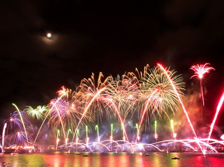 Riga, Latvia - November 18, 2018. Multi-colored fireworks exhibition Saules Muzs (The Life of the Sun) during programme of the the 100th anniversary of the Proclamation of the Republic of Latvia