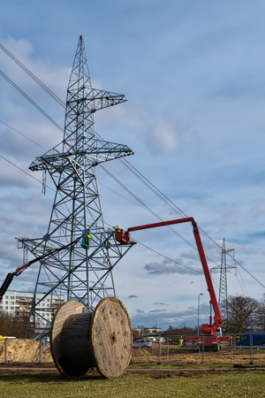 Building of a new high-voltage power transmission tower in progress.