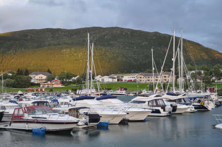 Nesna, Nordland/Norway - August 9 2016: View to the boats in Nesna port, Norway in cloudy summer evening