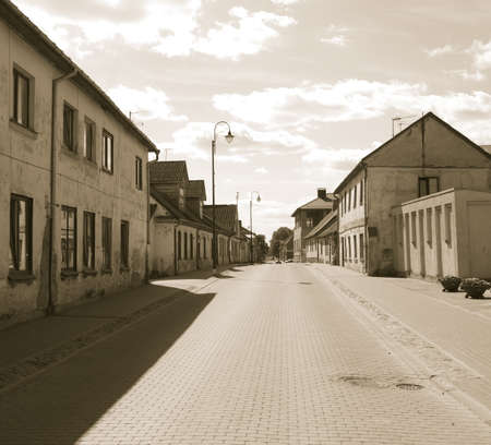 View in sepia to the city street of Bauska, Latvia