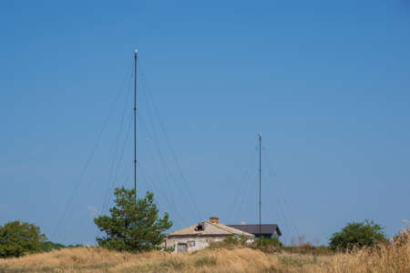 View to the old historical houses by the Sõrve lighthouse in Saaremaa island, Estonia, on hot and hazy summer day.