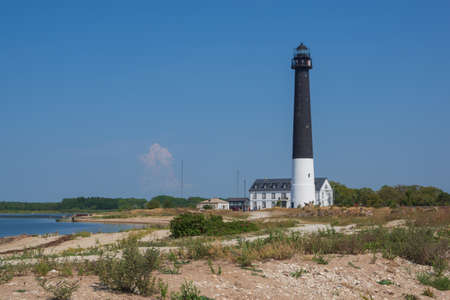 View to the Sõrve lighthouse in Saaremaa island, Estonia, on hot and hazy summer day.