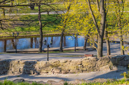 View from Bastion Hill in Bastejkalns park in Riga  to Riga City Canal on sunny spring day Banco de Imagens