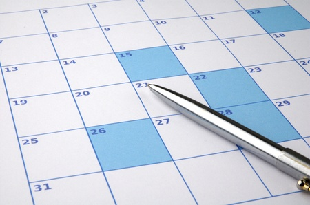 強調表示されている日付とペンの色のカレンダー 写真素材