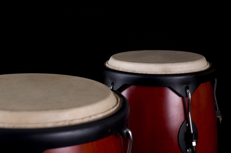djembe drum: Percussion instrument on a black background