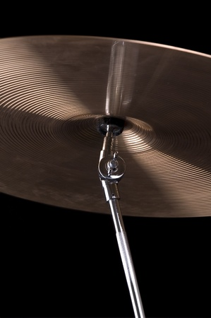 A cymbal on a black background Stock Photo