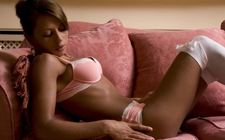 Beauty in lingerie lying on a sofa