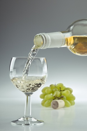 Pouring a glass of white wine photo