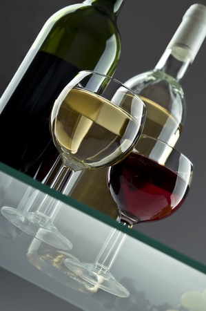 Red and white wine bottles and glasses photo