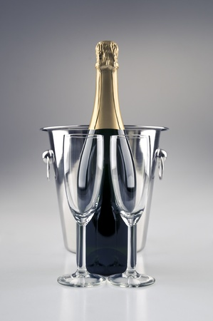 champagne cork: Champagne bottle and cooler and two glasses