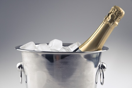 a champagne bottle in a ice bucket