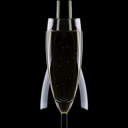Glass with champagne on a black background Stock Photo
