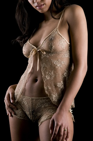Beauty in lingerie on a black background Stock Photo