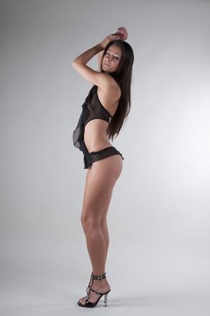 Brunette in standing in black lingerie photo