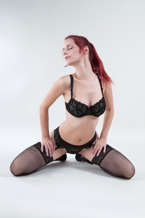 beautiful redhead wearing lingerie and high heels Stock Photo - 10276062