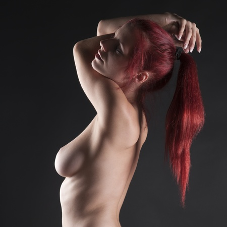 Artistic nude of a beautiful redhead Stock Photo