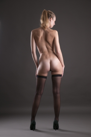 Beautiful woman nude with black stockings Stock Photo