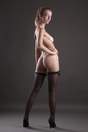 Beautiful woman nude with black stockings Stock Photo