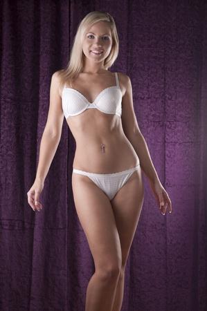 Blond beauty in white lingerie