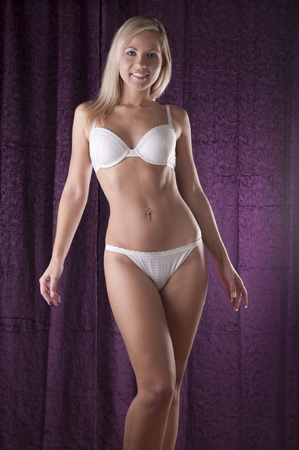 Blond beauty in white lingerie