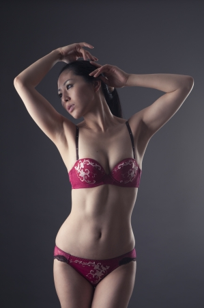 Beautiful asian woman posing in soft light photo