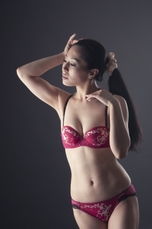 Beautiful asian woman posing in soft light