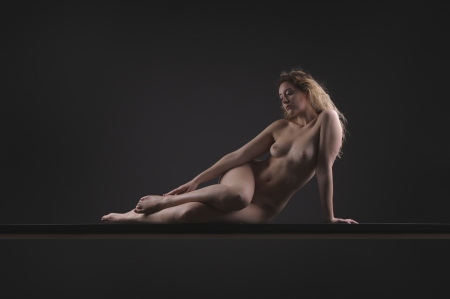naked woman sitting: Elegant female posing expression and form Stock Photo