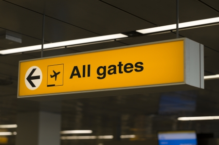 Sign with direction to all gates photo