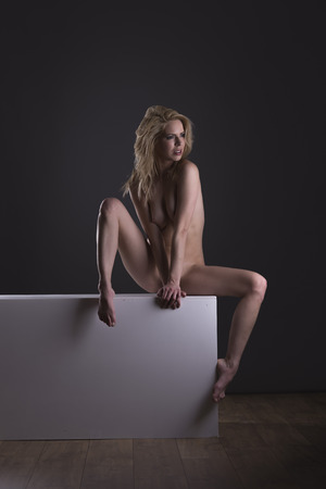 Beautiful nude blond female posing form and expression Stock Photo