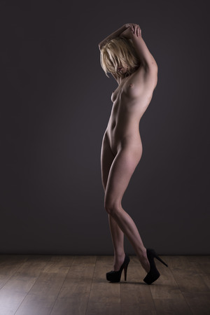 nude blond: Beautiful nude blond female posing form and expression Stock Photo