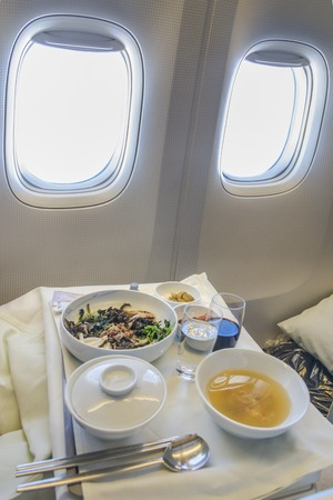 Set inflight meal on a tray, on a white table. Banco de Imagens