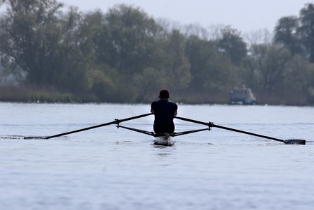 Man rowing in the waters of the Biesbosch in the Netherlands