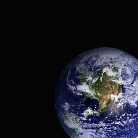 Globe against a black background photo