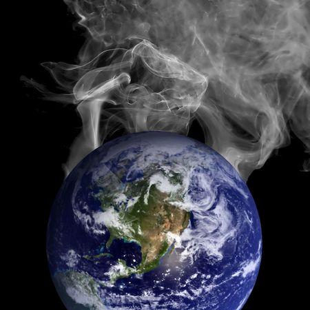 Globe with smoke coming of photo