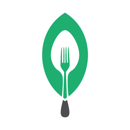 Fork and spoon with green leaf. Vegan food concept design.