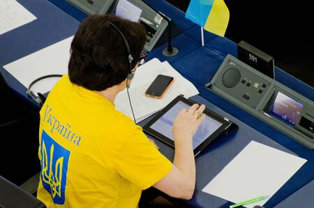 APRIL 16, 2013 - STRASBOURG, FRANCE: Former Latvian EU parliament deputy Sandra Kalniete sitting at the table in plenary hall with Ukraine supporting T-shirt