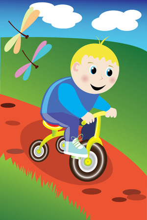 Little boy on the bike in the park