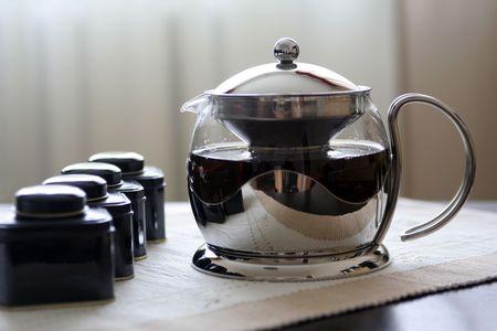 Teapot with fresh tea and tea boxes