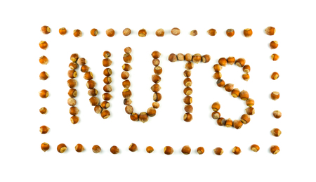 Nuts inscription made of hazelnuts