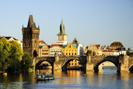 Charles bridge in Prague at sunset photo