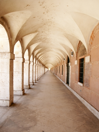 spanish culture: Long corridor in the exterior of the Royal Palace of Aranjuez