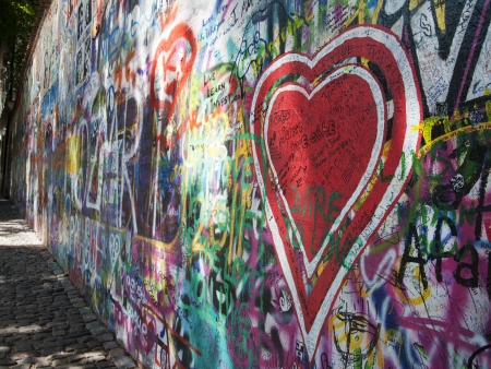 Heart Graffiti on Jonh Lennon Wall in Prague. When John Lennon was murdered in 1980 his portrait was painted on this wall. Since then the wall has been used for people to express themselves. During the communist era the authorities washed the wall but the