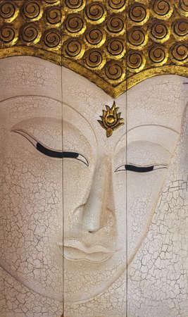 teak: Buddha face wood carving Stock Photo