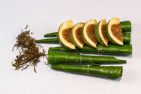 Areca nut, betel nut chewed with the betel leaf and lime photo