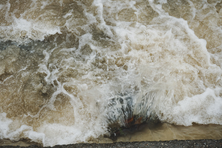 View of muddy river rapid and turbulent currents in Malaysia River - Image Stock Photo