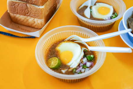 Specially made toasted bread with bean sauce served with egg, popular in State of Johor in Malaysia. Known as kacang pool. Selective focused and close up. - Image Stock Photo