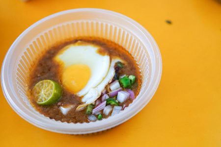 Specially made toasted bread with bean sauce served with egg, popular in State of Johor in Malaysia. Known as 'kacang pool'. Selective focused and close up. - Image