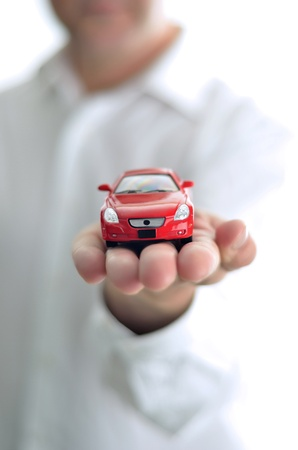 Businessman presents a toy car photo