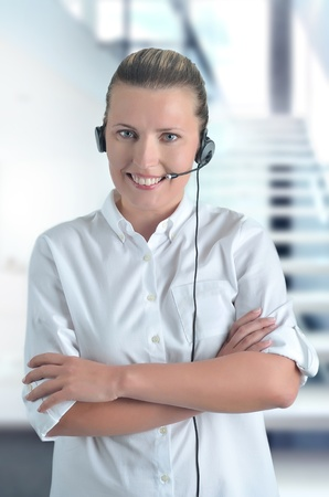 blondy beautiful girl with headphone in call center Stock Photo - 13150953